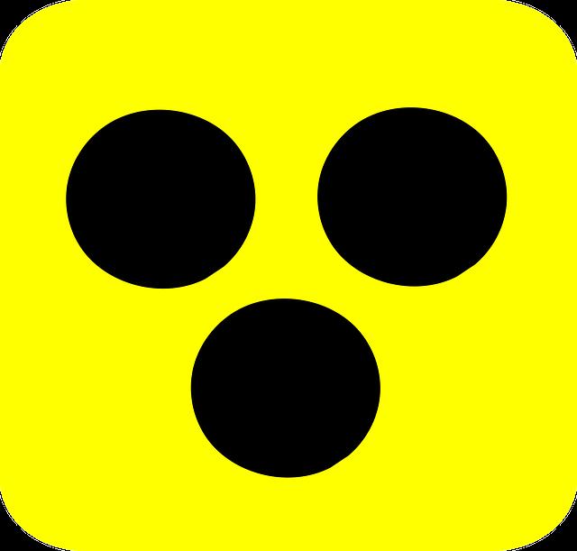 Blindenzeichen: drei schwarze Punkte auf gelbem Hintergrund